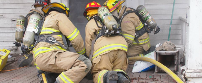 Firefighters with Oxygen tanks