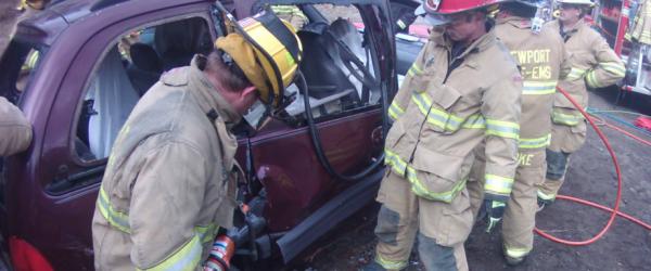 Firefighters prying open car door