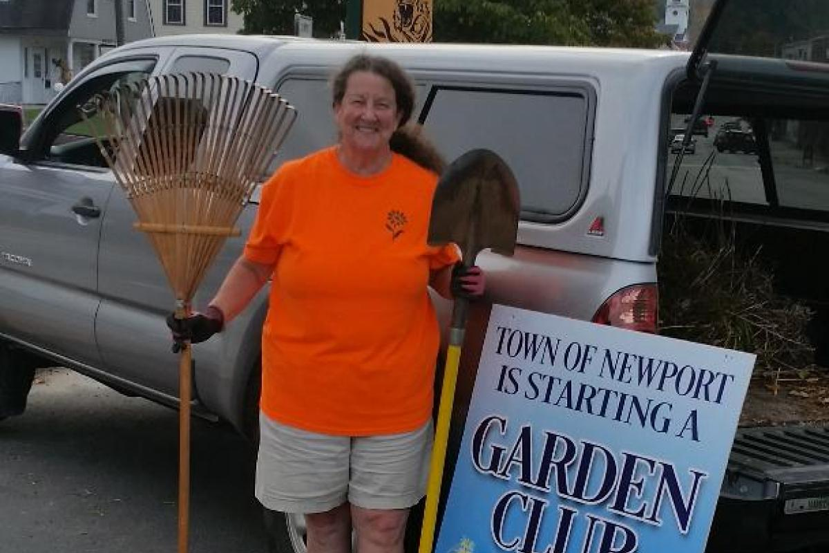 Newport resident and Member of the Garden Club, Sharon Rich, out on a Sunday morning cleaning up Main Street.